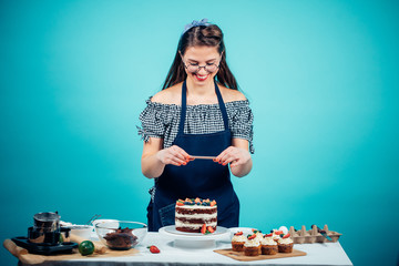 White caucasian woman taking pictures of delicious cup cakes with a smart phone.