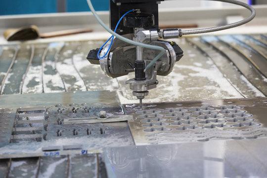waterjet metal cutting by cnc program