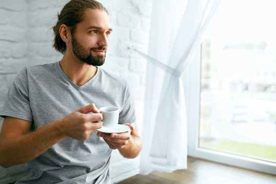 Man Drinking Coffee At Home In Morning.