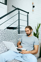 Young Man With Laptop At Home.