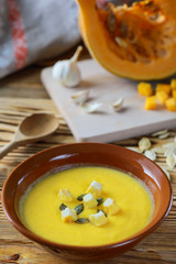 Cream soup of pumpkin on a wooden table