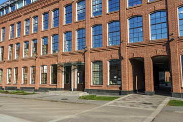 Fototapeta Office building of red brick in the yard of the old factory
