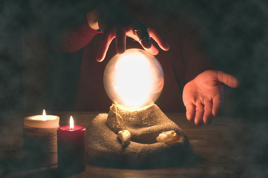 Crystal ball and fortune teller hands. Divination concept. The spiritual seance. Future reading.