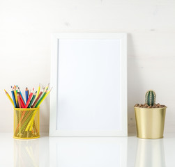 Mockup with clean white frame, colored pencils and succulent on white background. Concept for creativity, drawing.