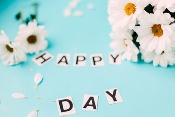 happy day white flowers, letters HAPPY