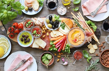 Foto op Plexiglas Voorgerecht Mediterranean appetizers table concept. Diner table with tapas selection: cured meat and salami, gazpacho soup, jamon, olives, cheese, hummus and vegetables. Overhead view.