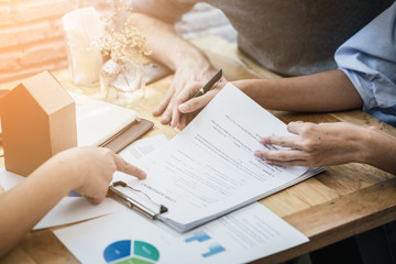 success business contract deasl with sale represent and clients meeting with paper document contract and pen close up on wooden table and background