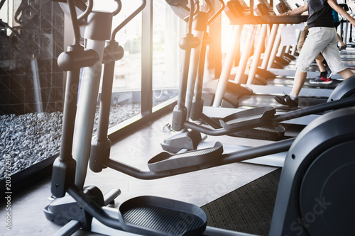 workout concept wite healthy people running on treadimill