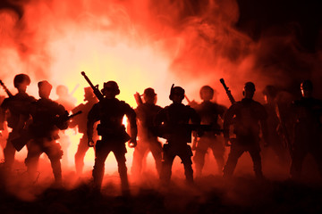 Anti-riot police give signal to be ready. Government power concept. Police in action. Smoke on a dark background with lights. Blue red flashing sirens. Dictatorship power