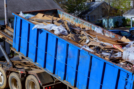 recycling garbage collector truck loading waste and removable container.