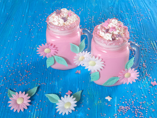 Pink unicorn milk shake with whipped cream, sugar and sprinkles