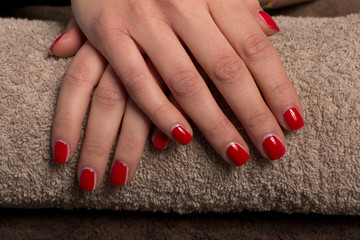 Beautiful Manicure nail paint color at salon spa