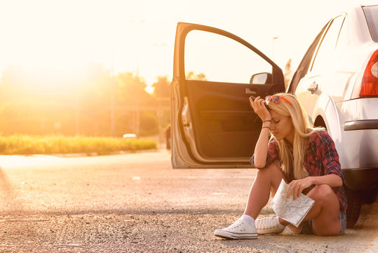 Beautiful young woman traveler lost on highway