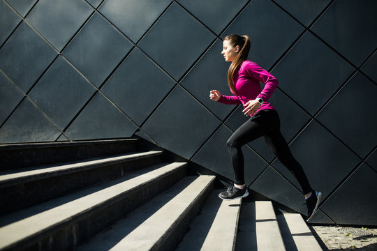 Athletic woman running up stairs during cardio. interval training