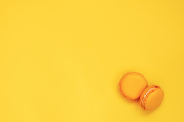 Fotobehang Top view of yellow macaroons over yellow background. Copy space.