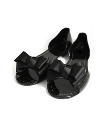 A pair of fancy stylish black woman summer shoe with ribbon bow, isolated on a white background.