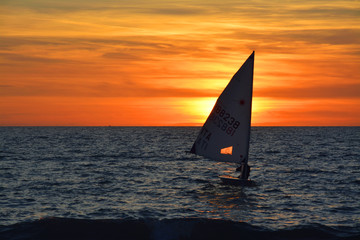 Boat sailing against sky during sunset