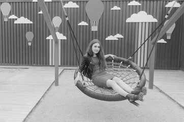 girl on the Playground swinging on a swing