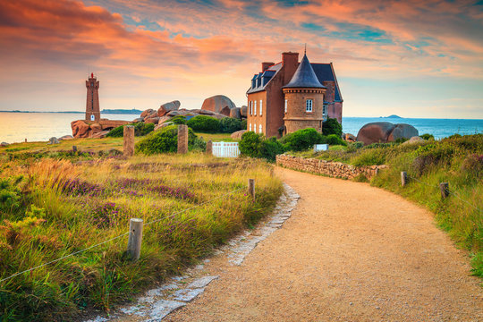 Spectacular walkway and lighthouse in Brittany region, Ploumanach, France, Europe