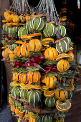 colorful Xmas decorations with dry fruits with oranges, lemons and cinnamoms