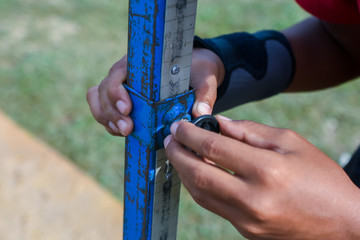 measuring the high jump athletics with nice background
