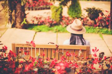 girl tourist travel in flower garden weekend holiday