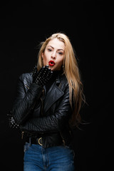 Image of young blonde in leather jacket
