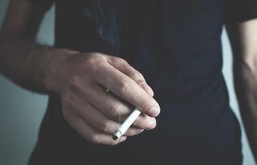 Caucasian man holding cigarette. Smoking concept