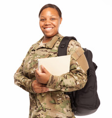 Happy female soldier in multicam uniform and going to college.