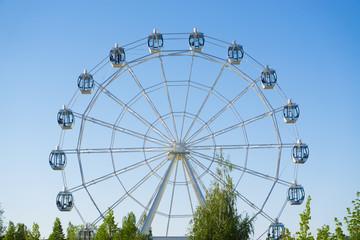 Ferris wheel on blue sky background