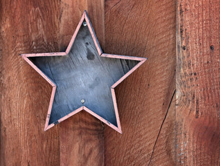 star decoration on a wooden wall