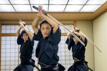 Samurai training in a traditional dojo in Tokyo