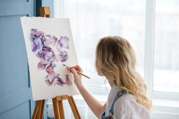 artist lifestyle. painting hobby. woman drawing beautiful watercolor floral design