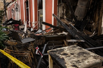 Burnt down restaurant ribbed by police in La Serena city.. Language translation: Police of Chile, do not cross