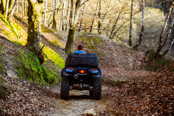 man ride ATV in the forest trail. journey concept