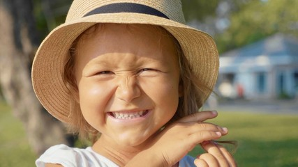 Portrait of beautiful cute little girl laughing and looking at camera