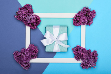 Happy Father's day or Birthday Pastel Candy Blue Colour Background. Floral flat lay greeting card with picture frame mock up and wrapped gift box.