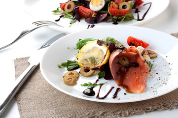 salmon salad white plate olives lemon sauce