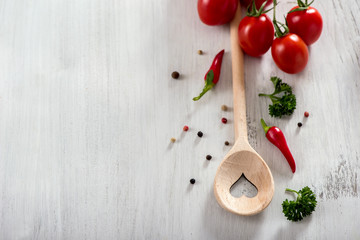 Cooking spoon and vegetables copy space food background, vegan or healthy cooking concept