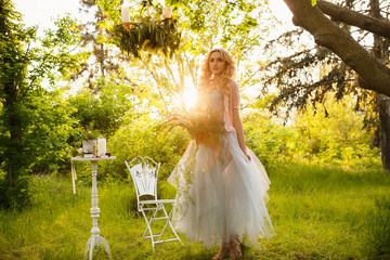 young beautiful girl posing at sunset in park, fairytale photography