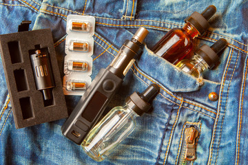 Vaping device and accessory. Vape concept. Useful as background or vape advertisement or vape  in a jeans pocket