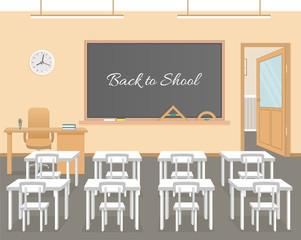 School classroom with chalkboard, white student desks and teacher's desk. School class room interior design.