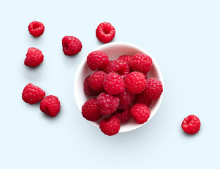 Bowl of raspberries isolated on white background