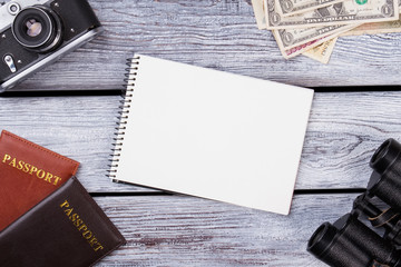 Passport travel concept and blank notepad. Flat lay design of work desk Planning with plane.