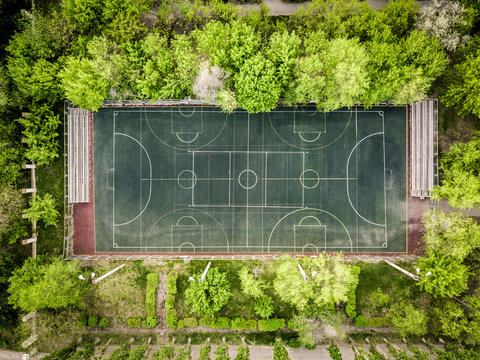 aerial basketball court top down overhead between the trees in the forest