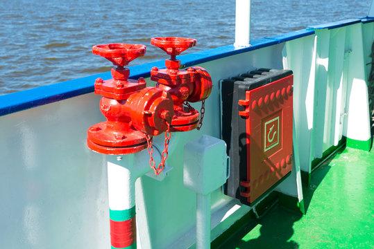 Red fireplugs on the ship