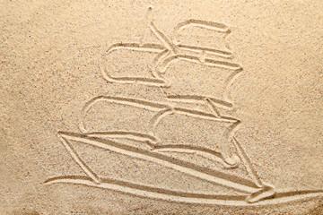 Ship drawn on beach sand