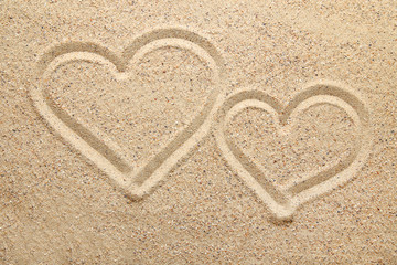 Heart drawn on beach sand