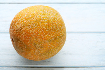 Sweet melon on wooden table