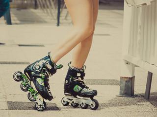 Woman legs wearing roller skates